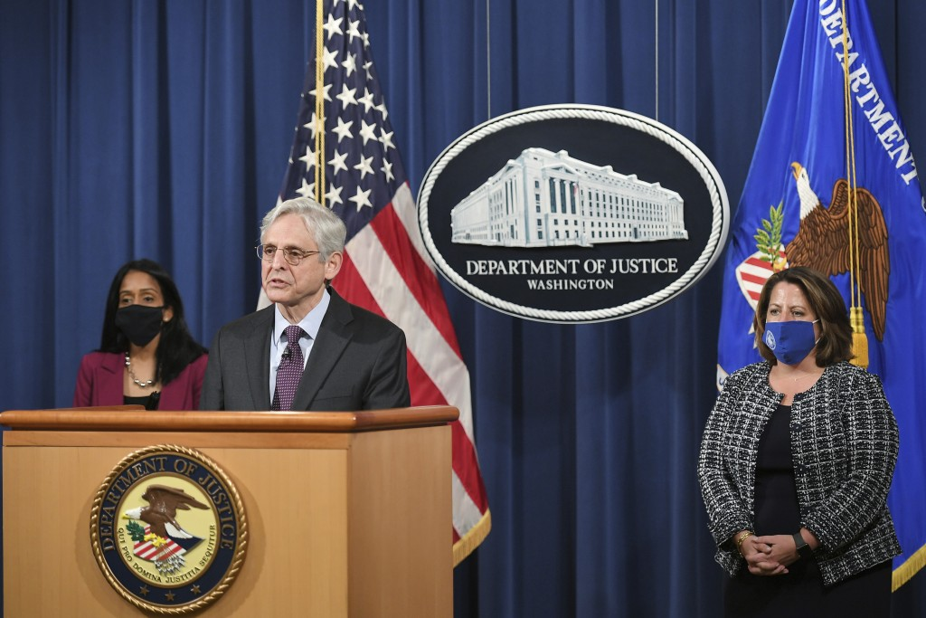 Attorney General Merrick Garland speaks at the Department of Justice in Washington, Monday, April 26, 2021, as associate Attorney General Vanita Gupta...