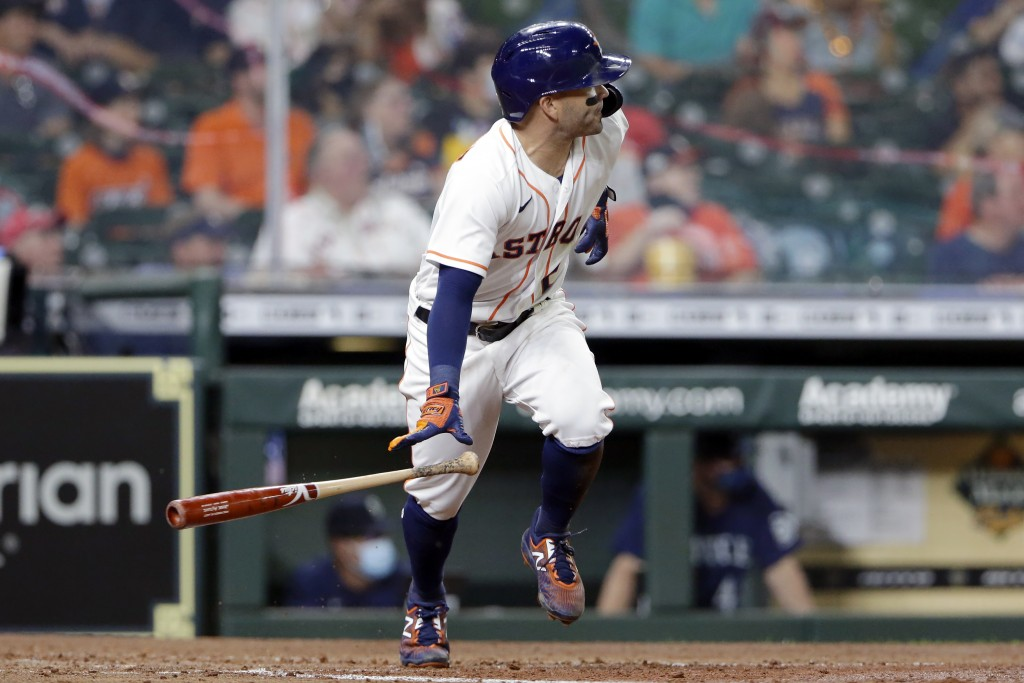 Houston Astros' Jose Altuve flips his bat as he watches his two-run RBI single against the Seattle Mariners during the fourth inning of a baseball gam...