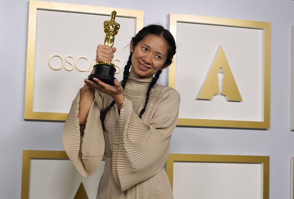 """Director/Producer Chloe Zhao, winner of the award for best picture for """"Nomadland,"""" poses in the press room at the Oscars on Sunday, April 25, 2021, a..."""