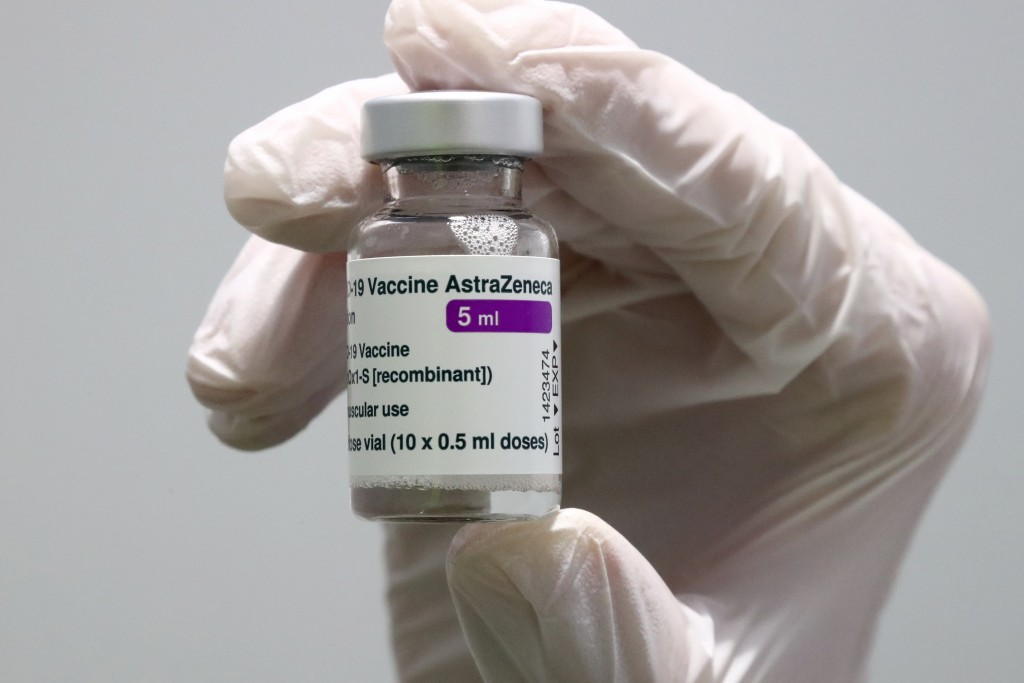 FILE - In this Monday, March 22, 2021 file photo medical staff prepares an AstraZeneca coronavirus vaccine during preparations at the vaccine center i...