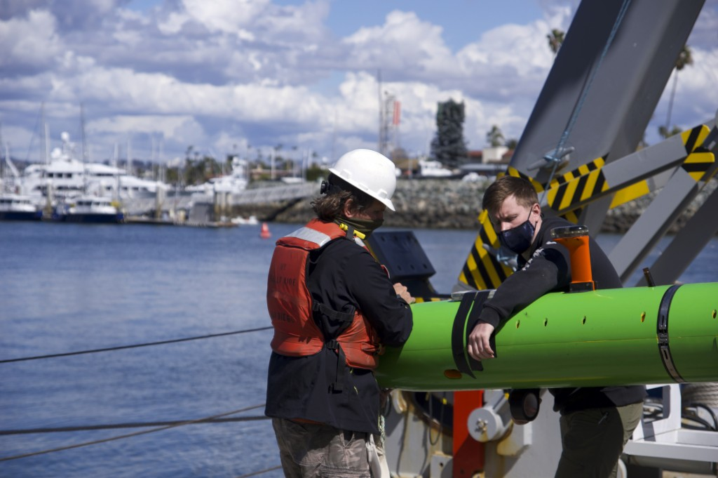 In this March 2021 image provided by Scripps Institution of Oceanography at UC San Diego, researchers aboard the research vessel Sally Ride recover an...