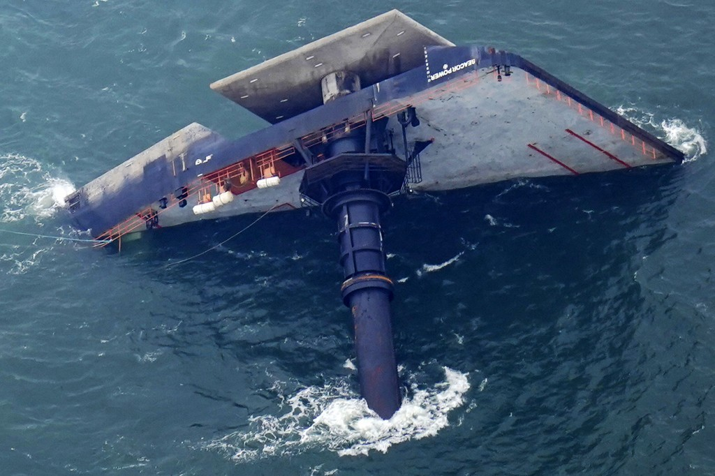 FILE - In this April 18, 2021 file photo, the capsized lift boat Seacor Power is seen seven miles off the coast of Louisiana in the Gulf of Mexico. Vo...