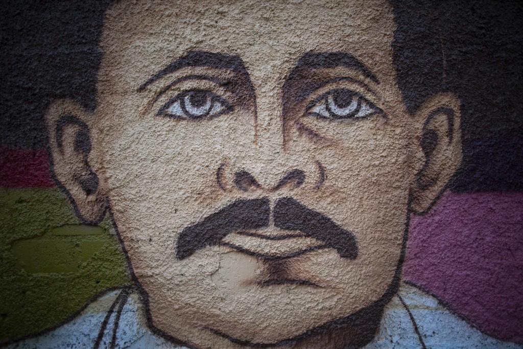 A mural of Venezuelan popular saint, Dr. Jose Gregorio Hernandez by Venezuelan artist Miguel Garcia, stands in Caracas, Venezuela, Monday, April 26, 2...