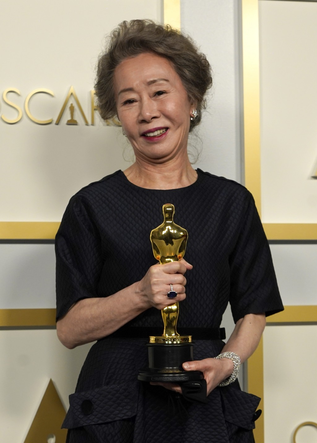 """Yuh-Jung Youn, winner of the award for best actress in a supporting role for """"Minari,"""" poses in the press room at the Oscars on Sunday, April 25, 2021..."""