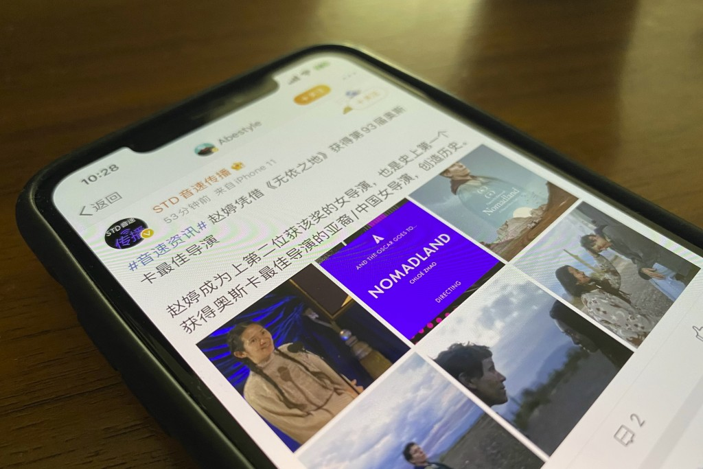 An online post writes about Chloe Zhao becoming the second female ever to win the Oscars for best director is displayed on a phone in Beijing on Monda...