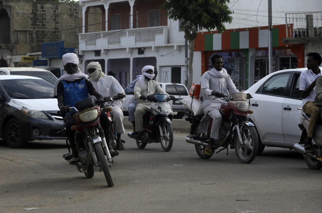 People travel during rush hour in N'Djamena, Chad, Monday, April 26, 2021. Chad's military transitional government said Sunday it will not negotiate w...