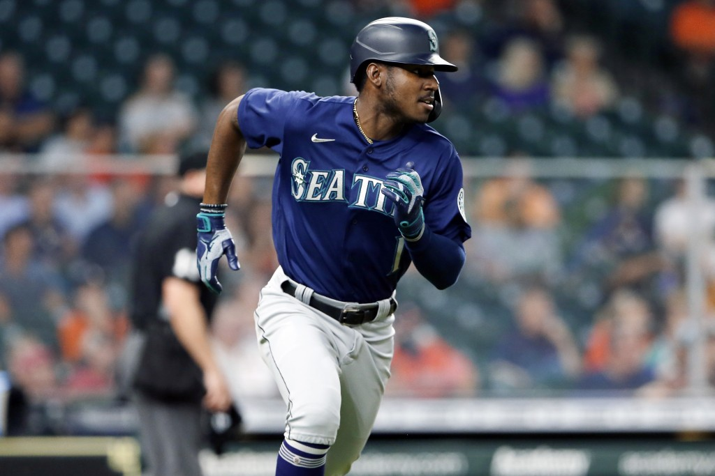 Seattle Mariners' Kyle Lewis rounds the bases on his home run during the third inning of a baseball game against the Houston Astros, Monday, April 26,...