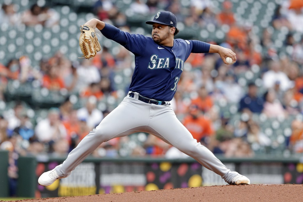 Seattle Mariners starting pitcher Justus Sheffield throws against the Houston Astros during the first inning of a baseball game Monday, April 26, 2021...
