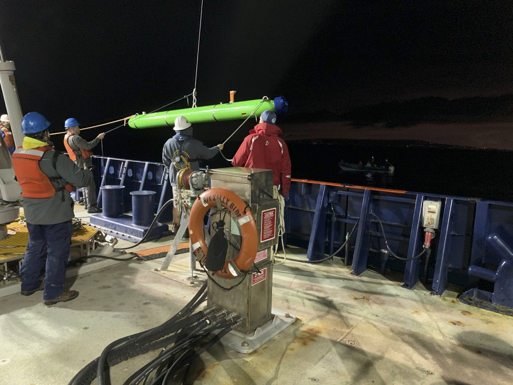 In this March 2021 image provided by Scripps Institution of Oceanography at UC San Diego, researchers aboard the research vessel Sally Ride deploy an ...