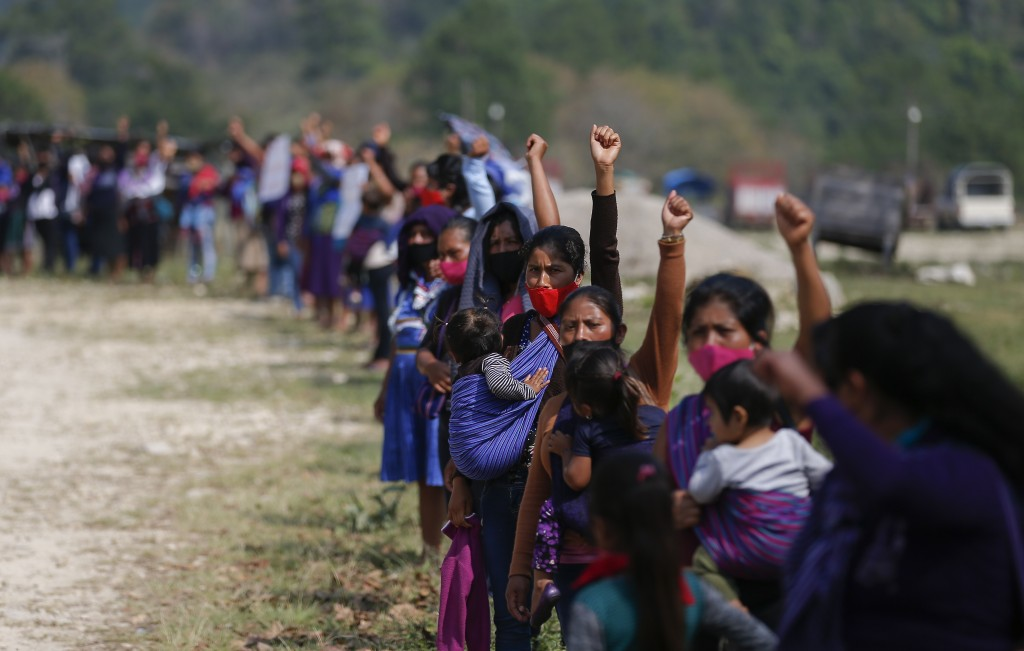 Members of the Zapatista Army of National Liberation, EZLN, shout a farewell to a delegation that will leave for Europe on May 3, in the community of ...