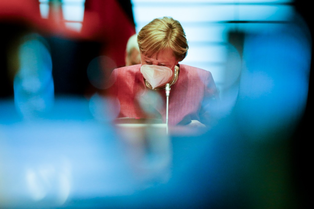 German Chancellor Angela Merkel reads in her documents after the arrives for the weekly cabinet meeting of the German government at the chancellery in...