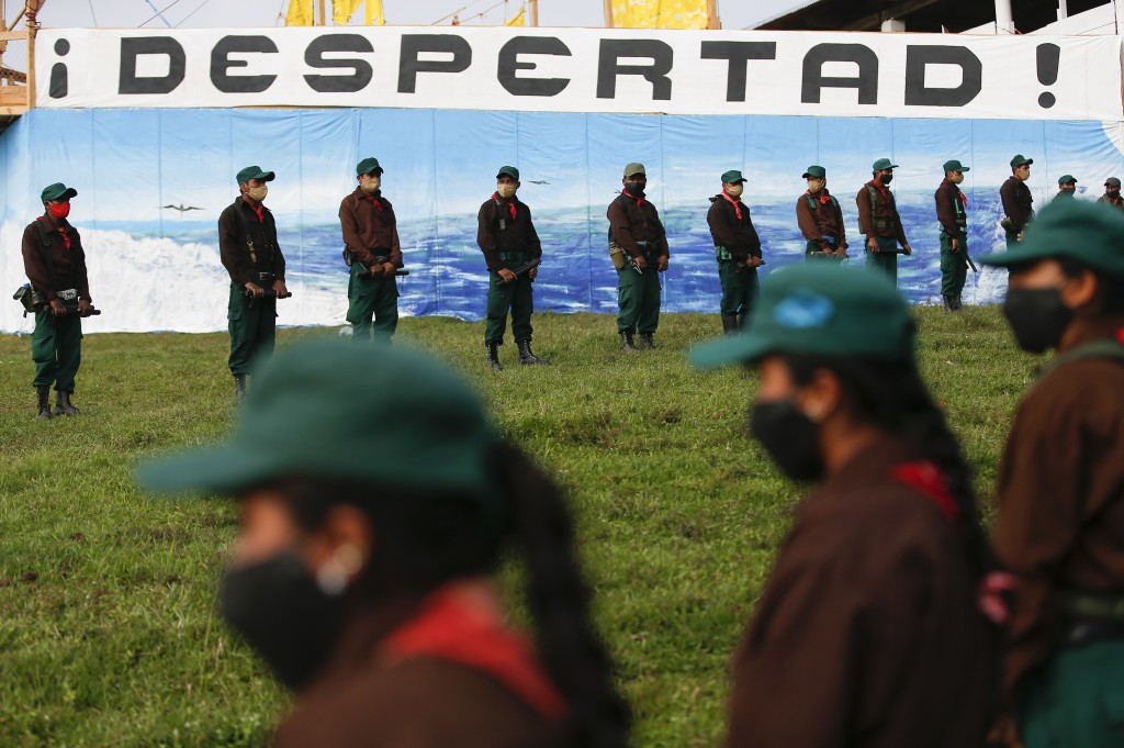 Members of the Zapatista Army of National Liberation, EZLN, wait to bid farewell to a delegation that will leave for Europe on May 3, in the community...