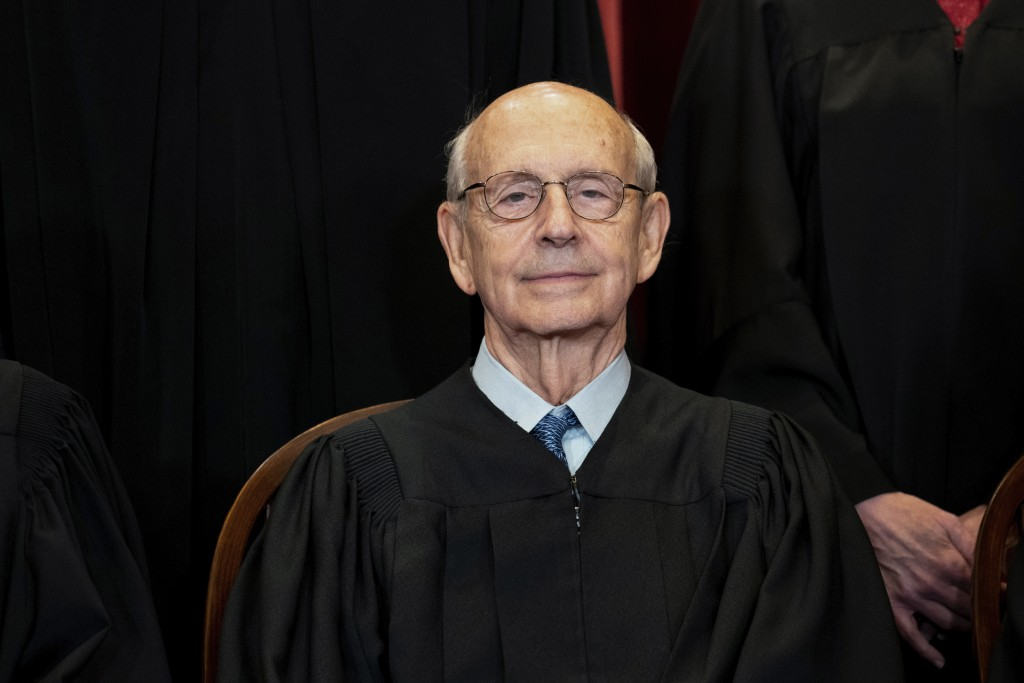 In this April 23, 2021, photo, Supreme Court Associate Justice Stephen Breyer sits during a group photo at the Supreme Court in Washington. (Erin Scha...
