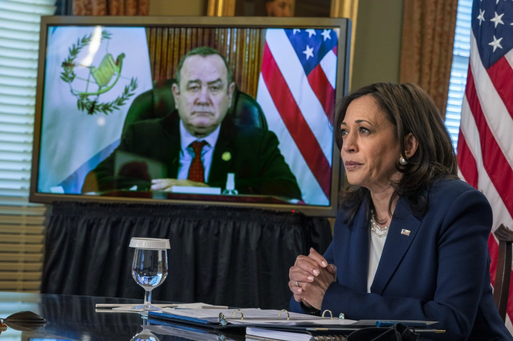 Vice President Kamala Harrismeets virtually with Guatemala's President Alejandro Giammattei, seen on screen at left, Monday, April 26, 2021, from her...