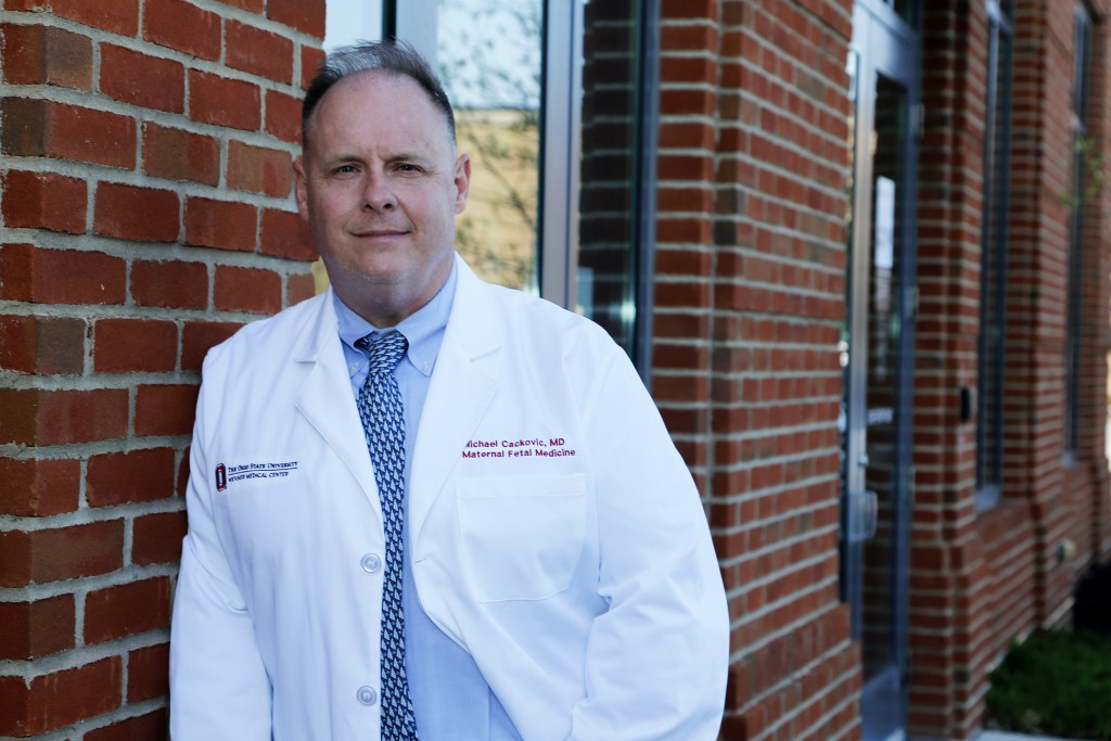 Dr. Michael Cackovic, an OB/GYN who works at Ohio State University's Wexner Medical Center, stands outside the Ohio State Outpatient Care facility Fri...