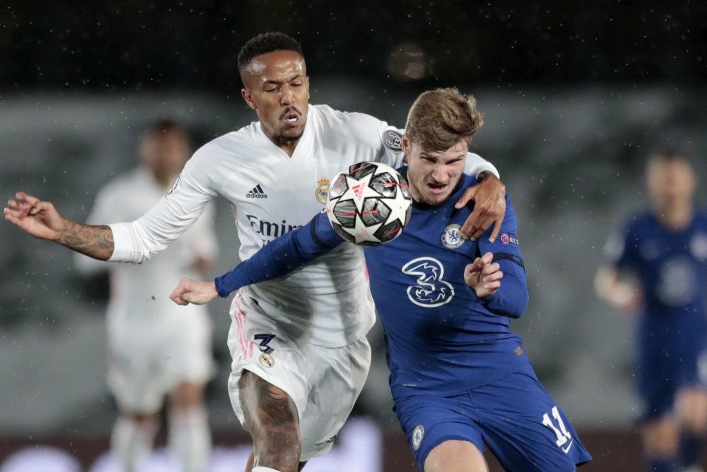 Chelsea's Timo Werner vies for the ball with Real Madrid's Eder Militao, left, during the Champions League semifinal first leg soccer match between Re...