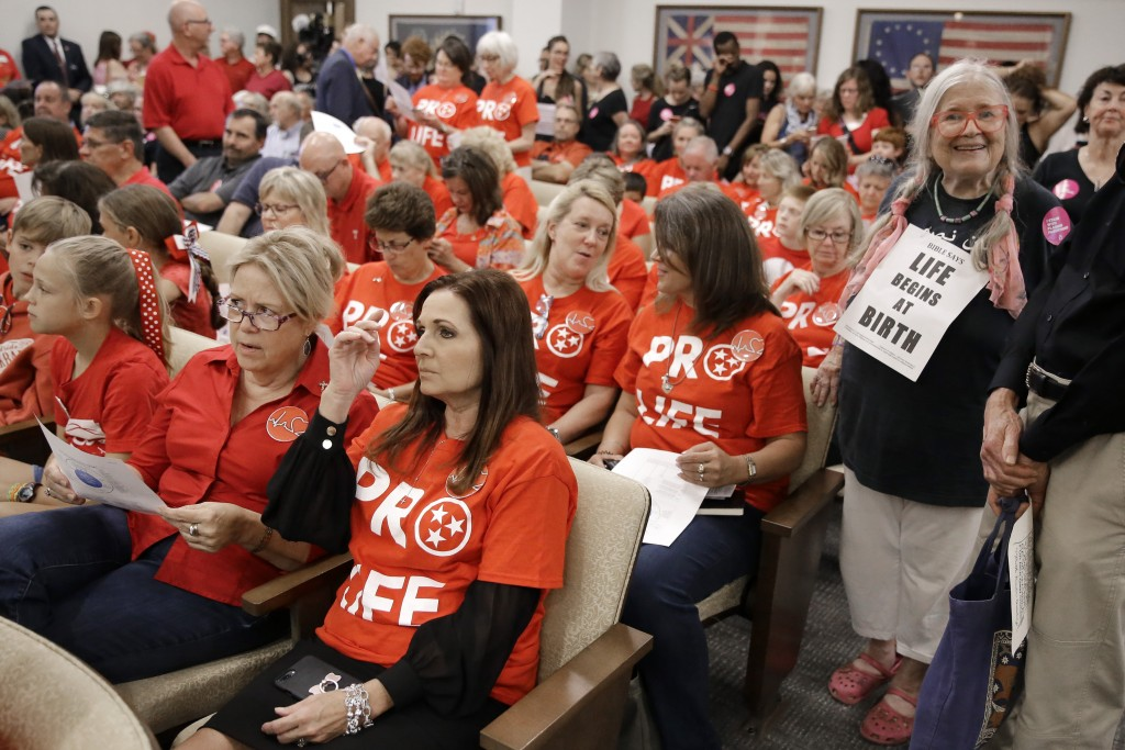 FILE - In this Aug. 12, 2019, file photo, people wait for a Senate hearing to begin to discuss a fetal heartbeat abortion ban, or possibly something m...