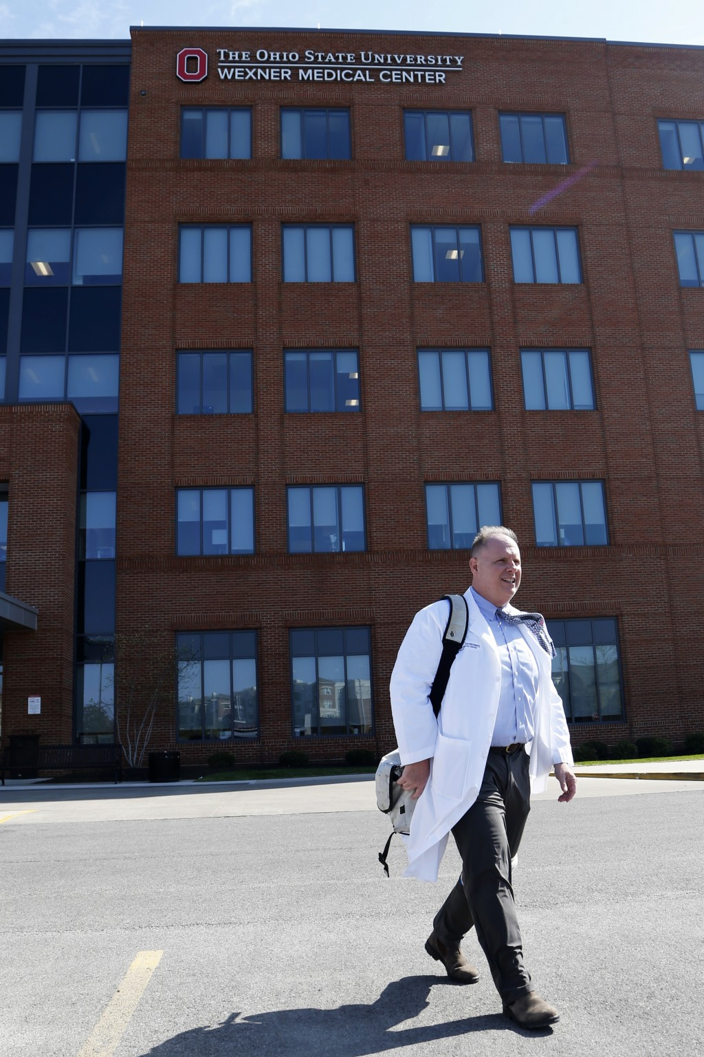 Dr. Michael Cackovic, an OB/GYN who works at Ohio State University's Wexner Medical Center, walks through the parking lot of the Ohio State Outpatient...