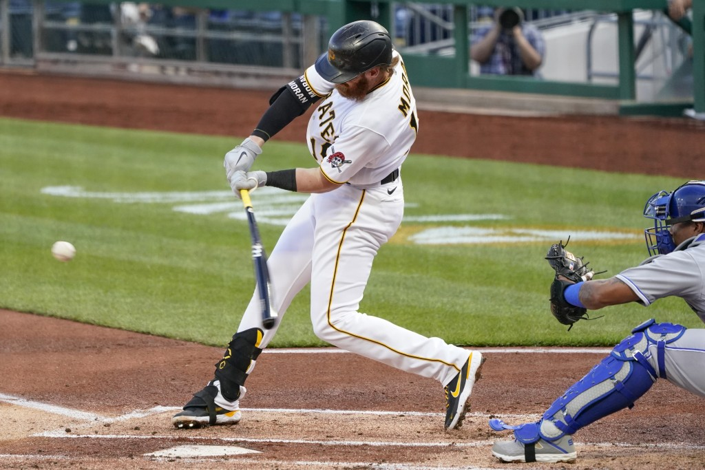 Pittsburgh Pirates' Colin Moran hits a single to drive in Bryan Reynolds from second in the first inning of a baseball game against the Kansas City Ro...