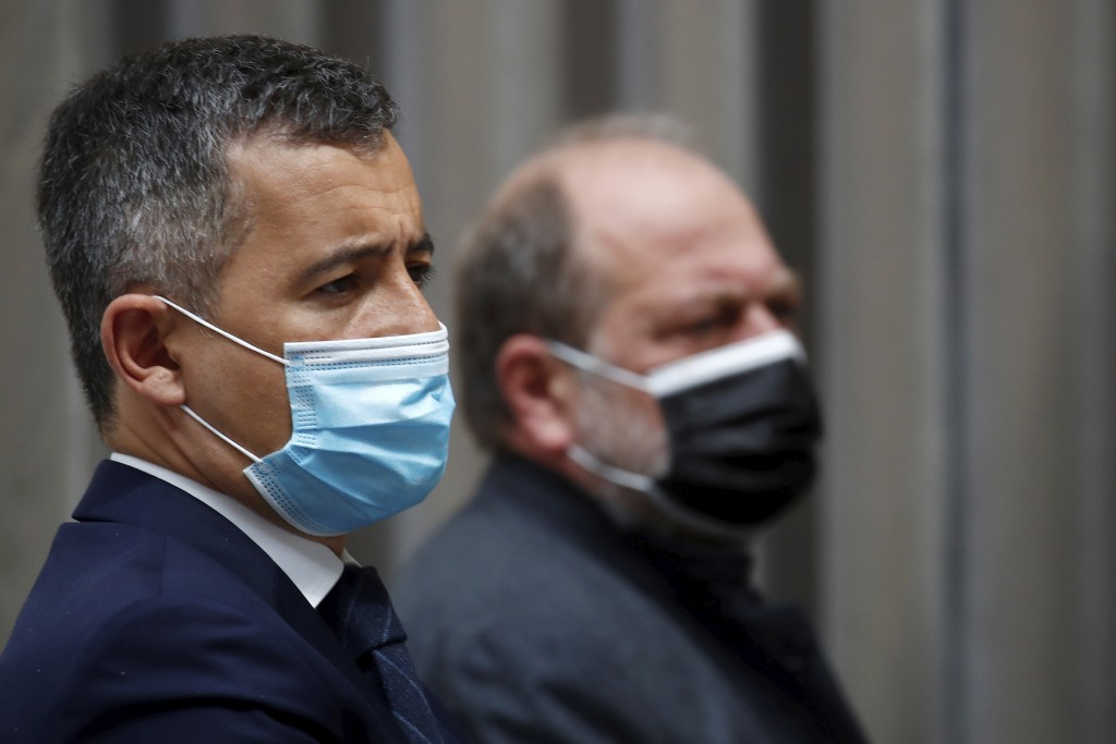 French Interior Minister Gerald Darmanin and Justice Minister Eric Dupond-Moretti, wearing protective face masks, attend a news conference following t...