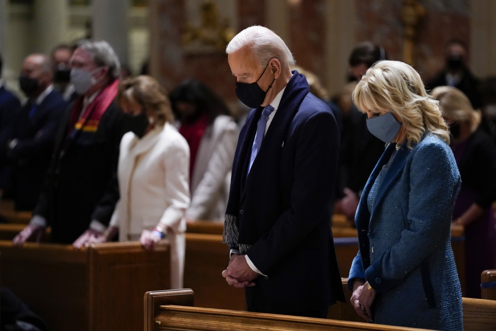 FILE - In this Wednesday, Jan. 20, 2021 file photo, President-elect Joe Biden and his wife, Jill Biden, attend Mass at the Cathedral of St. Matthew th...