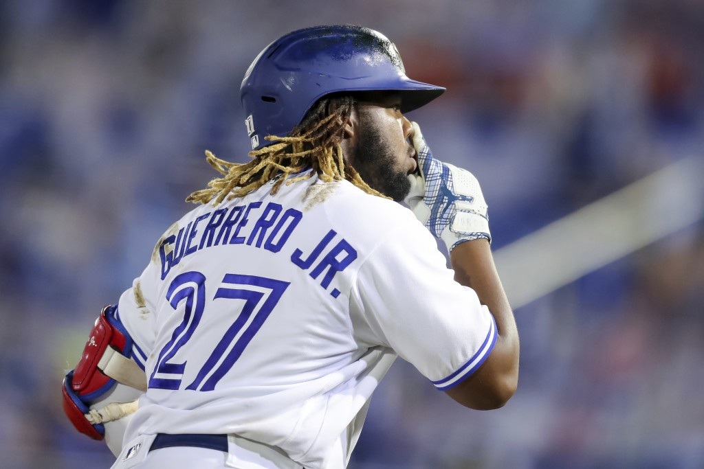 Toronto Blue Jays' Vladimir Guerrero Jr. gestures rounding third base after hitting his third home run against the Washington Nationals during the sev...