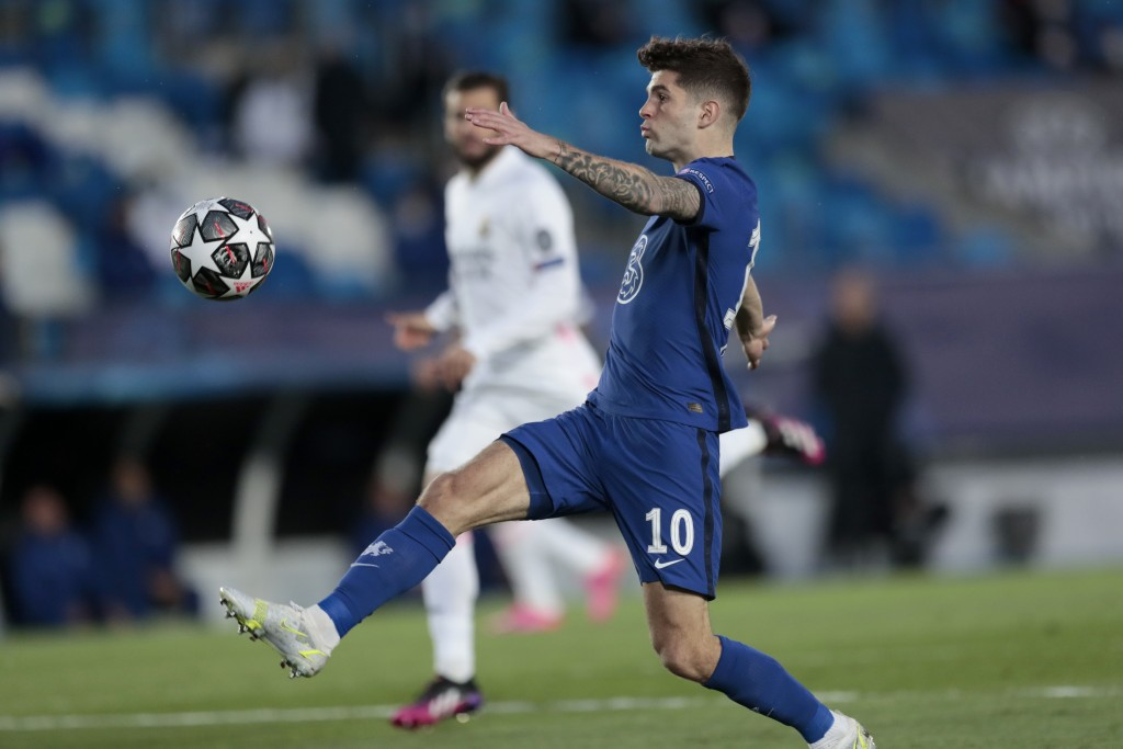Chelsea's Christian Pulisic reaches for the ball during the Champions League semifinal first leg soccer match between Real Madrid and Chelsea at the A...