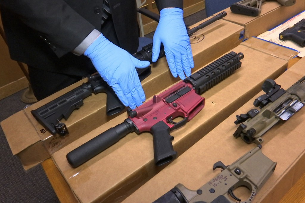 """FILE - In this file photo taken Wednesday, Nov. 27, 2019, is Sgt. Matthew Elseth with """"ghost guns"""" on display at the headquarters of the San Francisco..."""