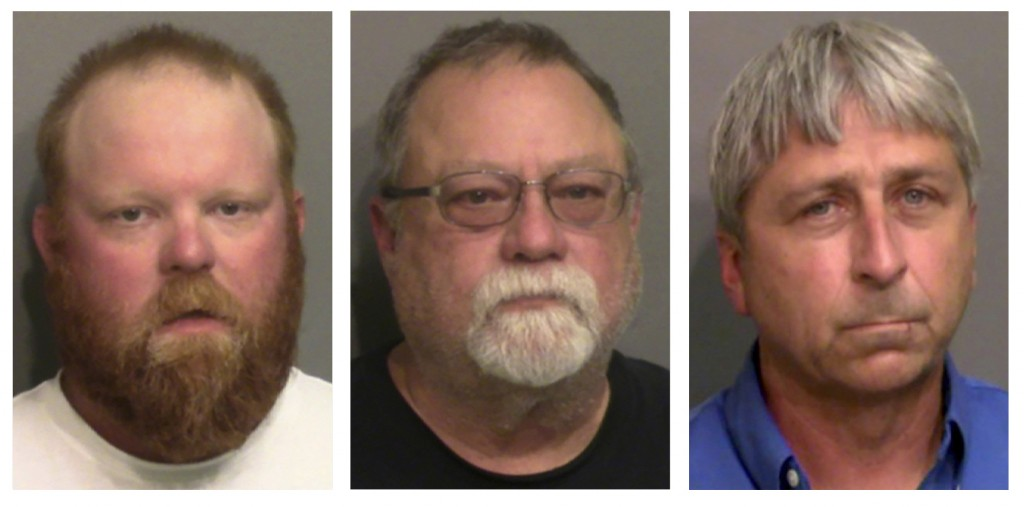 FILE - This combo of booking photos provided by the Glynn County, Ga., Detention Center, shows from left, Travis McMichael, his father Gregory McMicha...