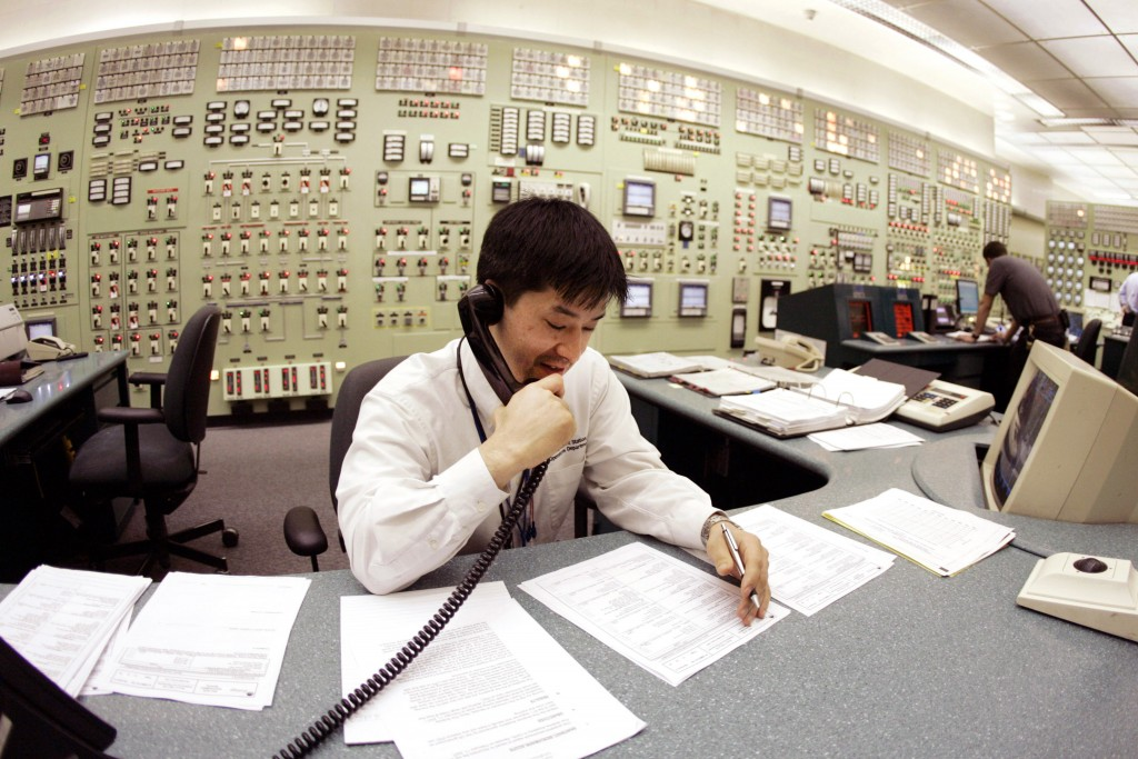 FILE - In this April 20, 2007, file photo, Tracy Sudoko, a control room agent at the Indian Point Energy Center, works on a report at the facility in ...
