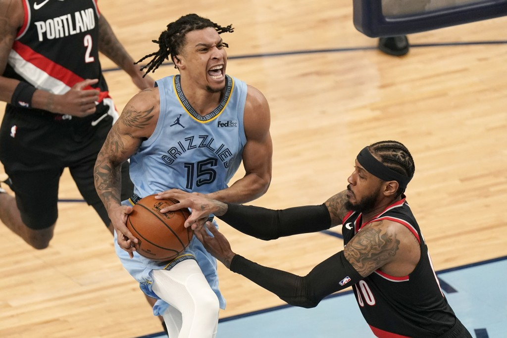 Memphis Grizzlies' Brandon Clarke (15) drives against Portland Trail Blazers' Carmelo Anthony (00) in the first half of an NBA basketball game Wednesd...