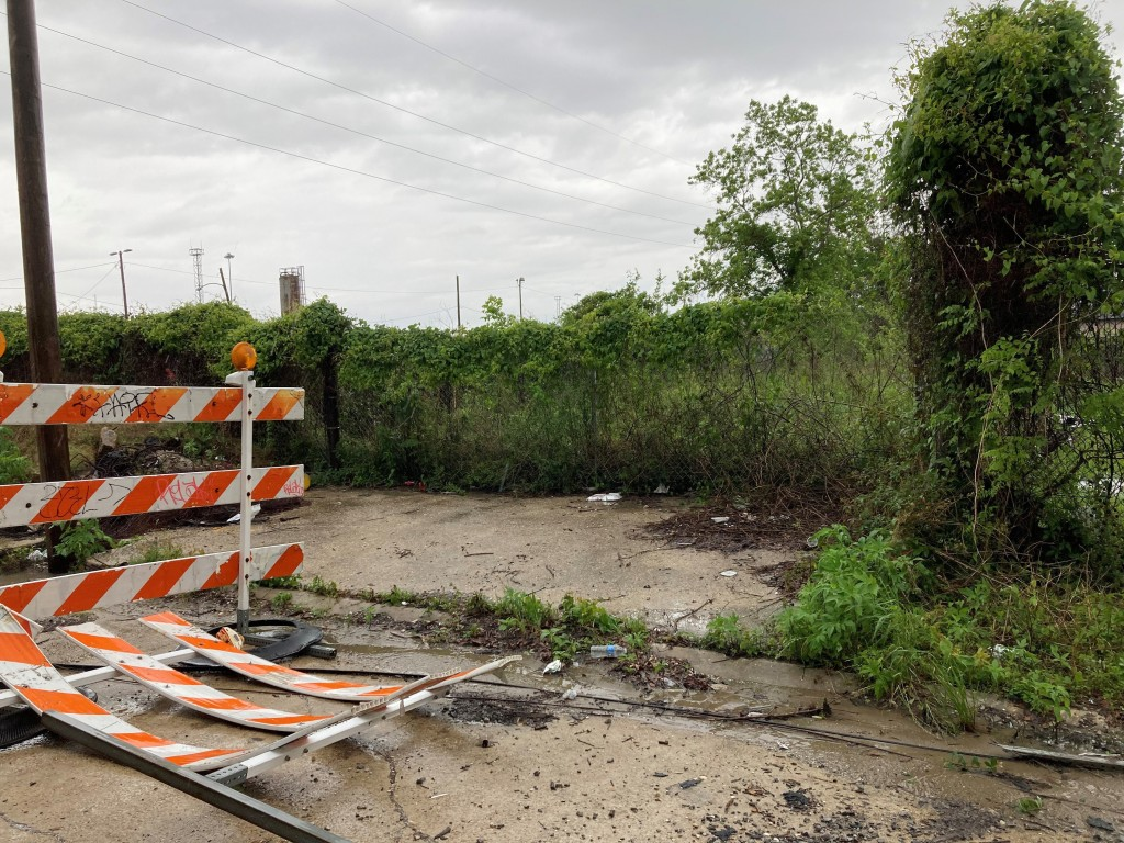 This Wednesday, April 14, 2021, photo shows the area next to a railroad overpass in New Orleans, where authorities earlier recovered a chair carved ou...