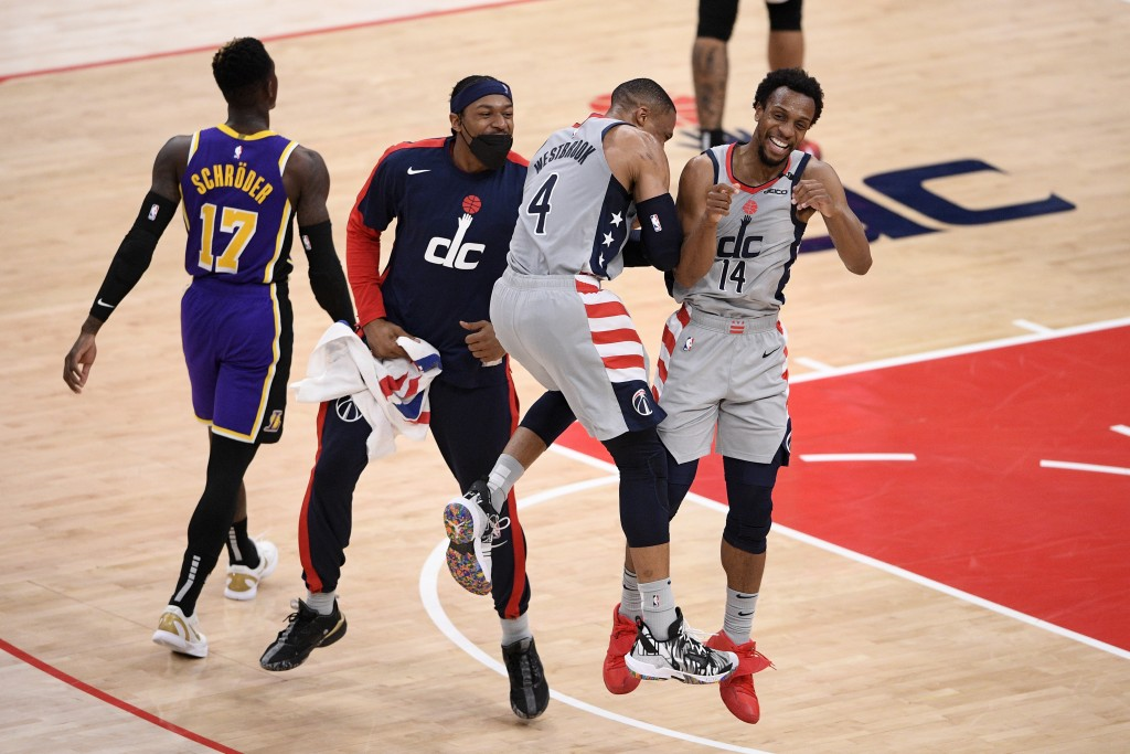 Washington Wizards guard Ish Smith (14) celebrates after his dunk with guard Russell Westbrook (4) and guard Bradley Beal, second from left, during th...