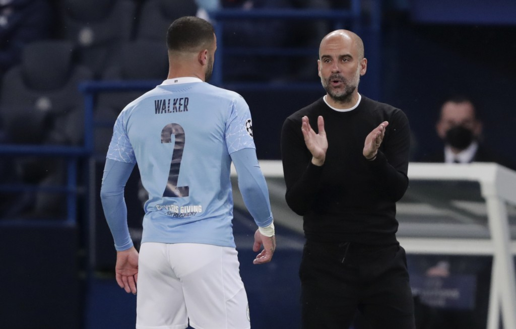 Manchester City's head coach Pep Guardiola, right, talks to Manchester City's Kyle Walker during the Champions League semifinal first leg soccer match...