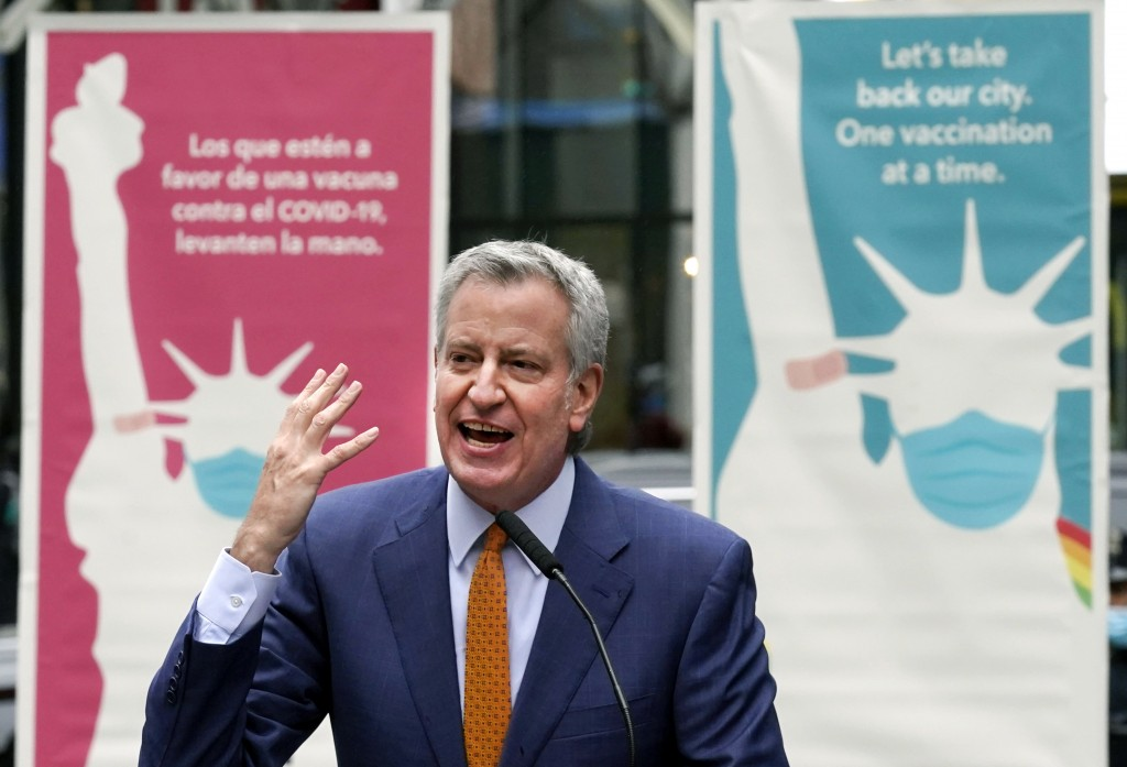 FILE - In this Monday, April 12, 2021 file photo, New York Mayor Bill de Blasio delivers remarks in Times Square after he toured the grand opening of ...