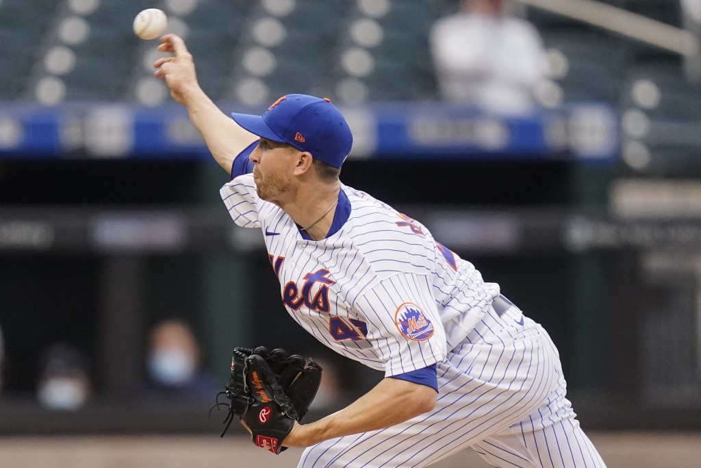 New York Mets' Jacob deGrom delivers a pitch during the first inning of a baseball game against the Boston Red Sox Wednesday, April 28, 2021, in New Y...