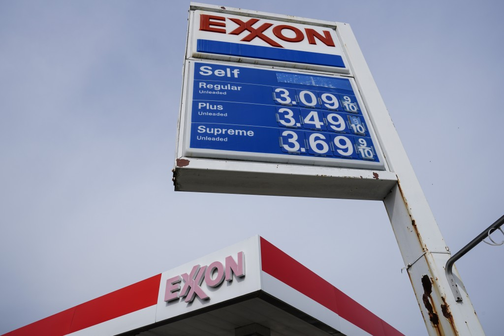 Gas prices are shown on a Exxon service station sign in Philadelphia, Wednesday, April 28, 2021.  Commodities like plastic, paper, sugar and grains ar...