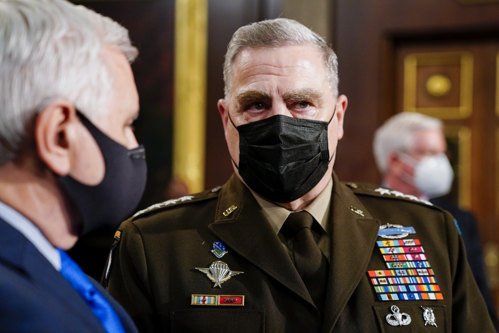 Joint Chiefs Chairman Gen. Mark Milley arrives to the chamber ahead of President Joe Biden speaking to a joint session of Congress, Wednesday, April 2...
