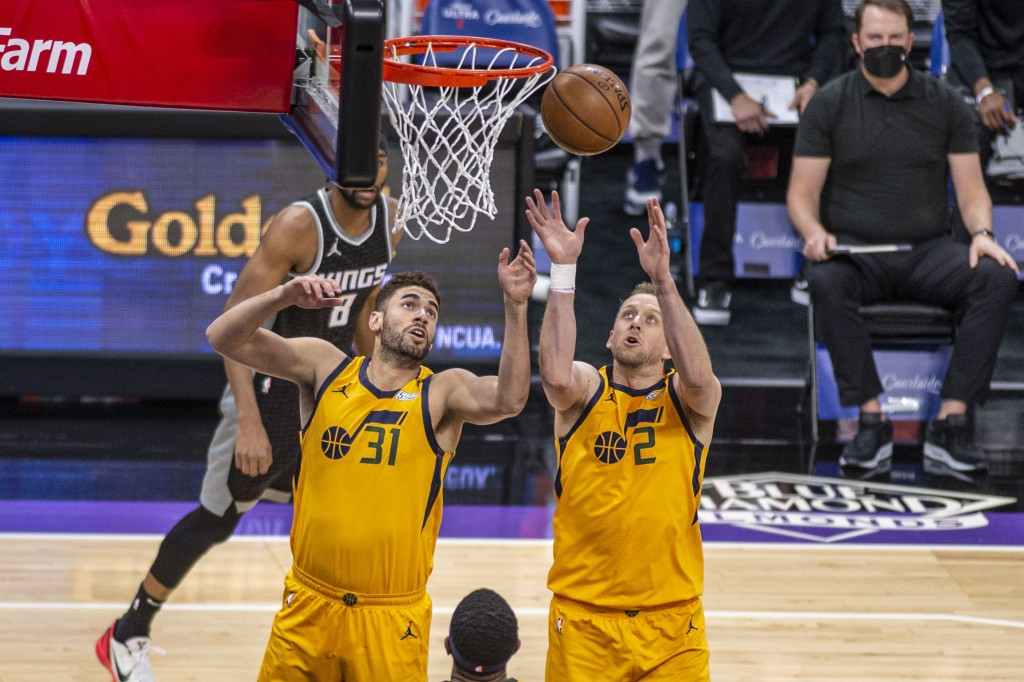 Utah Jazz forward Georges Niang (31) and Utah Jazz guard Joe Ingles (2) reach for a defensive rebound against the Sacramento Kings during the first qu...