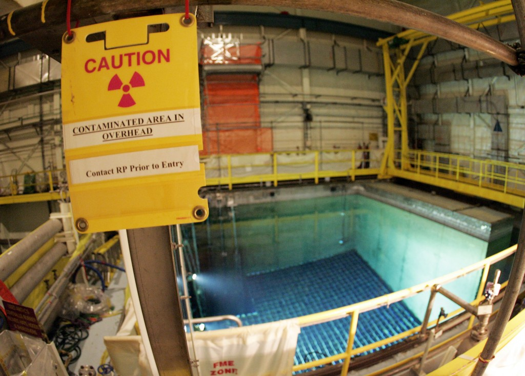 FILE — In this April 20, 2017, file photo, a caution sign marks an area surrounding a pool that protects spent nuclear fuel at the Indian Point Energy...