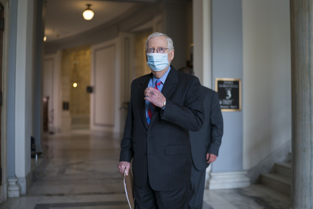 Senate Minority Leader Mitch McConnell, R-Ky., leaves a meeting with fellow Republicans on Capitol Hill in Washington, Thursday, April 29, 2021, the d...