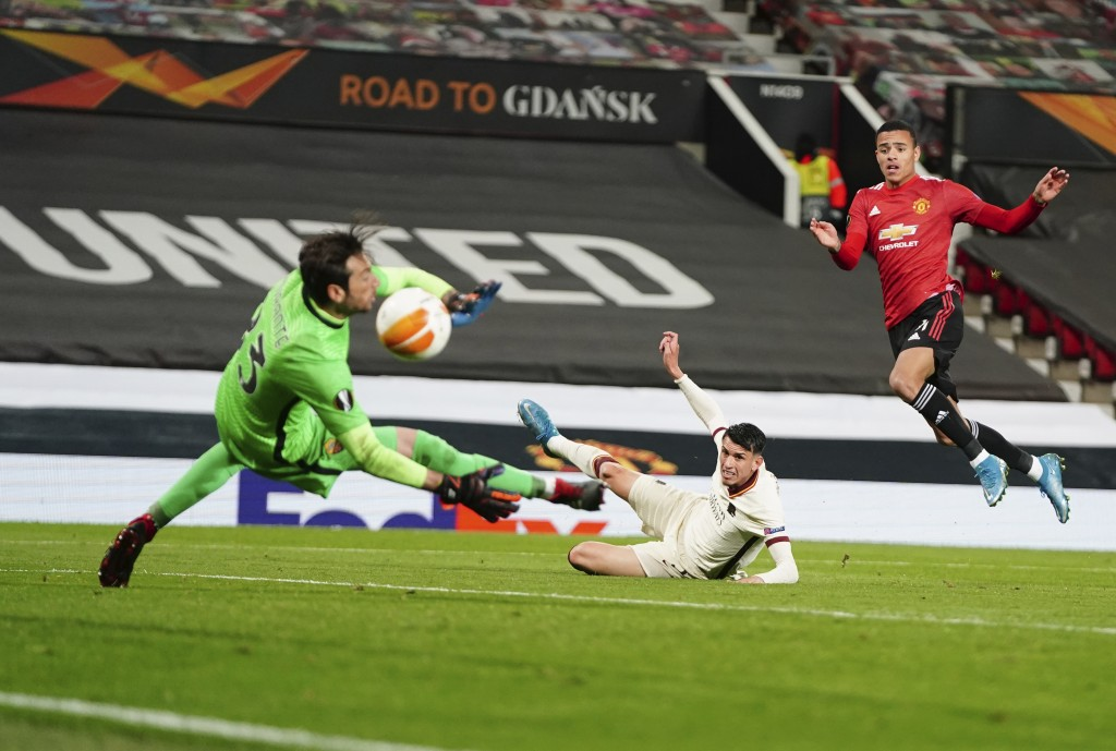 Manchester United's Mason Greenwood, right, scores his side's sixth goal during the Europa League semi final, first leg soccer match between Mancheste...
