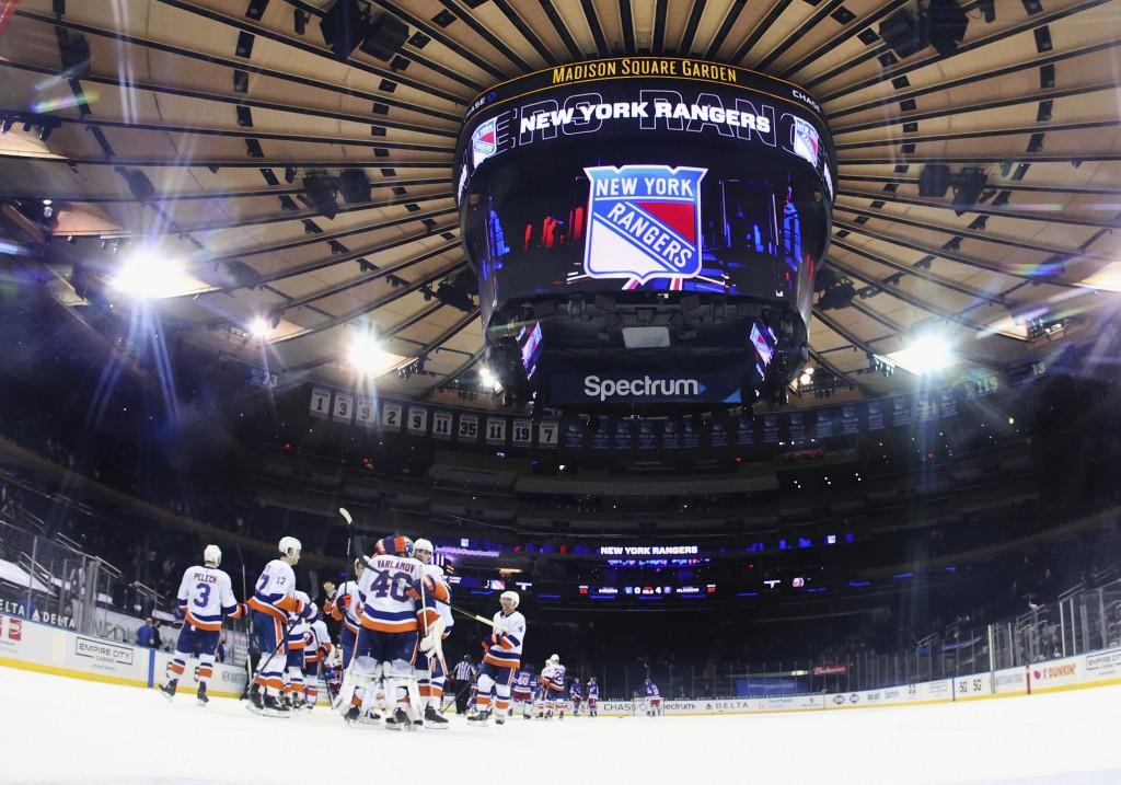 The New York Islanders celebrate a shutout against the New York Rangers in an NHL hockey game Thursday, April 29, 2021, in New York. (Bruce Bennett/Po...