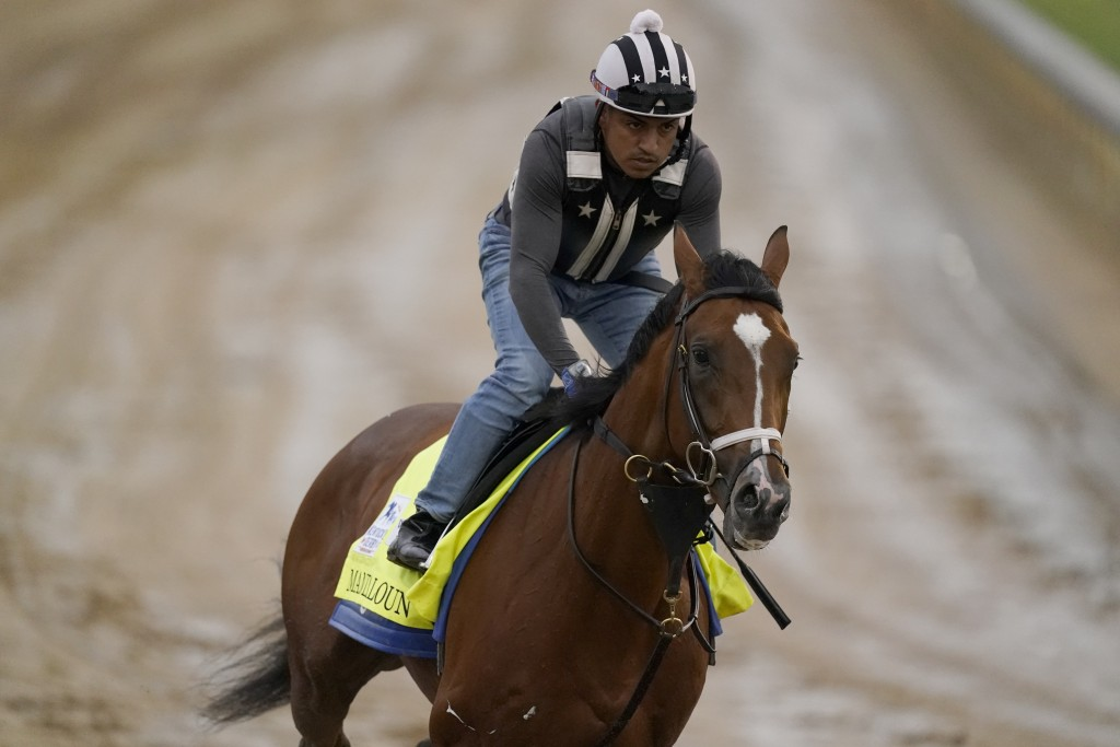 Kentucky Derby entrant Mandaloun works out at Churchill Downs Thursday, April 29, 2021, in Louisville, Ky. The 147th running of the Kentucky Derby is ...