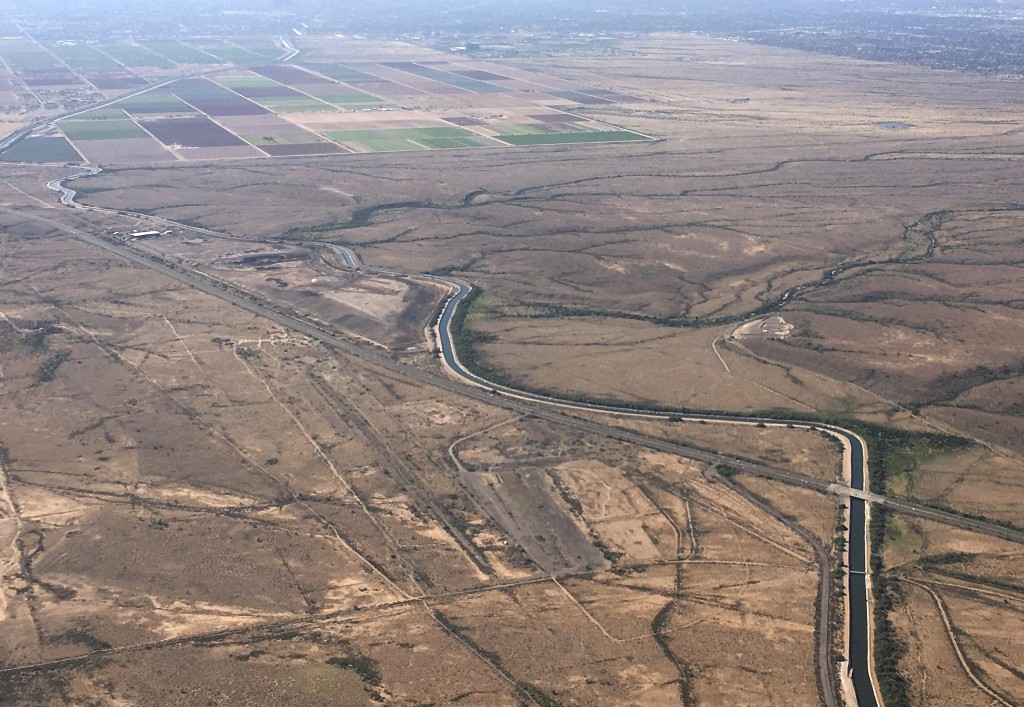 FILE - In this Oct. 8, 2019, file photo, the Central Arizona Project canal runs through rural desert near Phoenix. Water officials in Arizona say they...