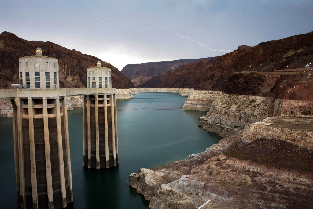 FILE - In this July 28, 2014, file photo, lightning strikes over Lake Mead near Hoover Dam that impounds Colorado River water at the Lake Mead Nationa...