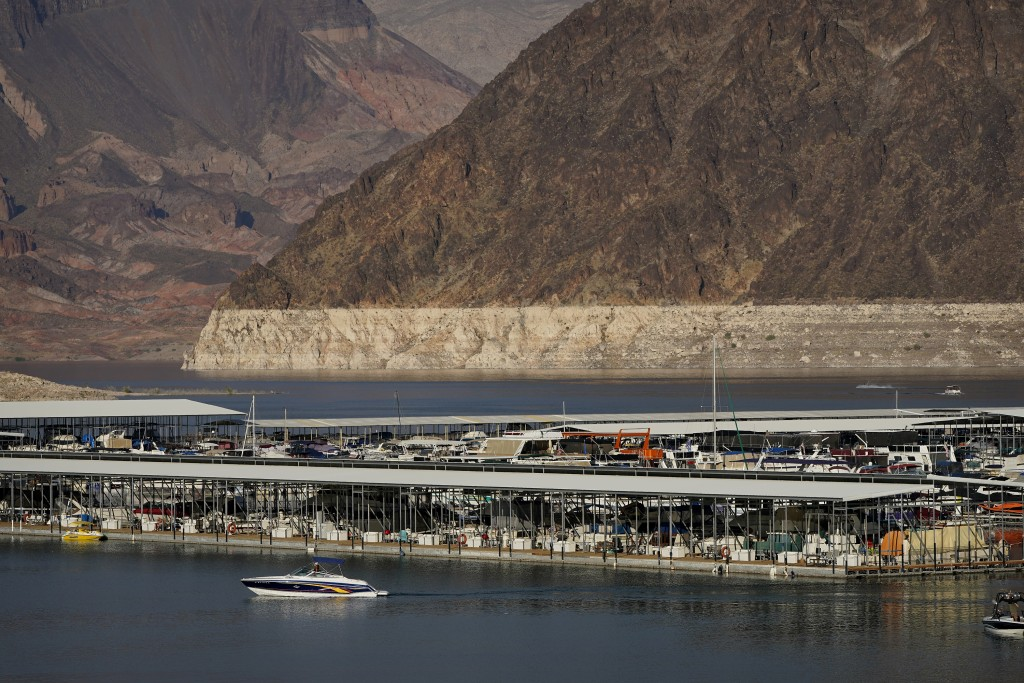 FILE - In this Aug. 13, 2020, file photo, a bathtub ring of light minerals delineates the high water mark on Lake Mead at the Lake Mead National Recre...