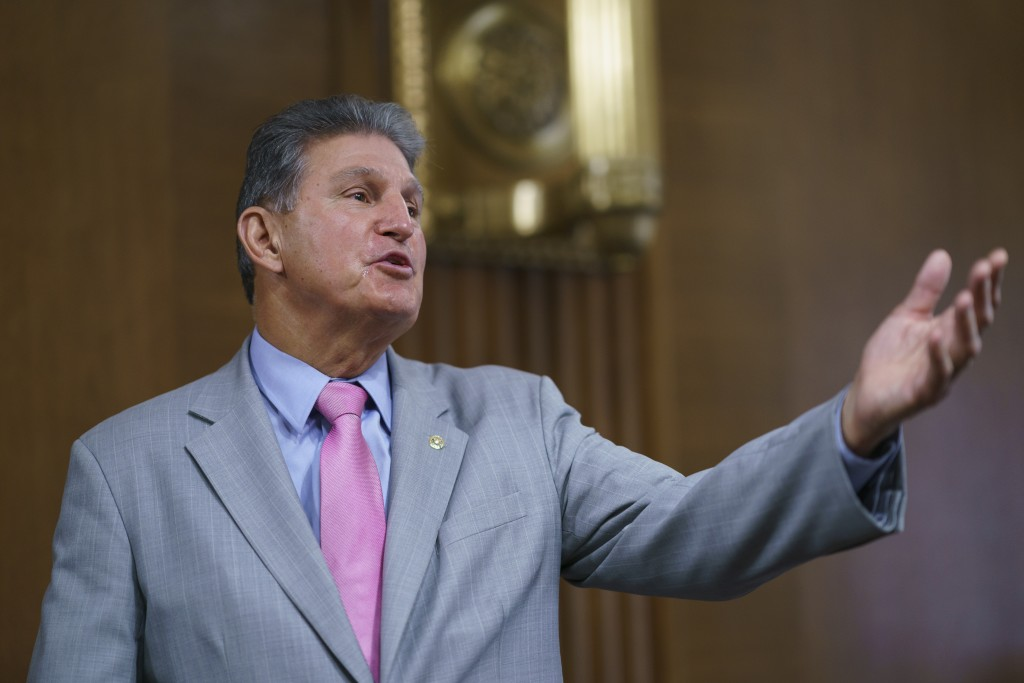 Sen. Joe Manchin, D-W.Va., chair of the Senate Energy and Natural Resources Committee, arrives to hold a confirmation hearing for Tommy Beaudreau of A...