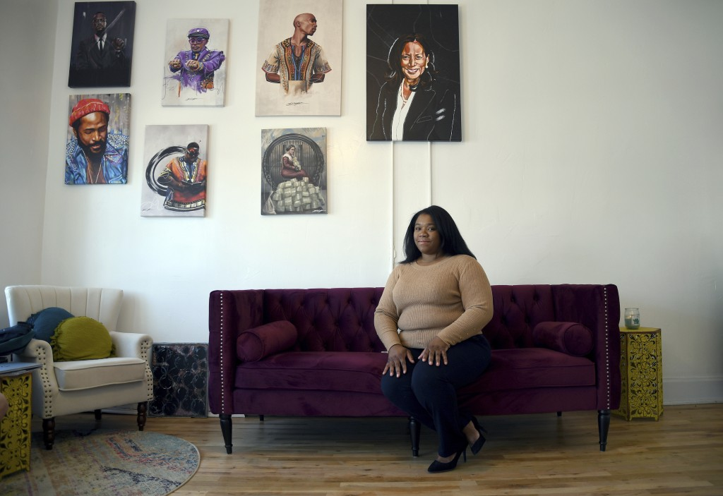 Sarah Woodson poses for a portrait in Denver on Saturday, April 3, 2021. Woodson, the executive director of the advocacy group The Color of Cannabis, ...
