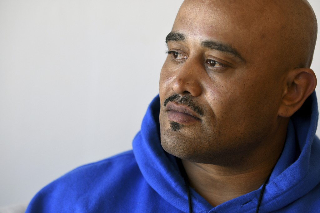 Terrence Hewing poses for a portrait in Denver on Saturday, April 3, 2021. Hewing, who was convicted of felony drug possession in suburban Denver in 2...